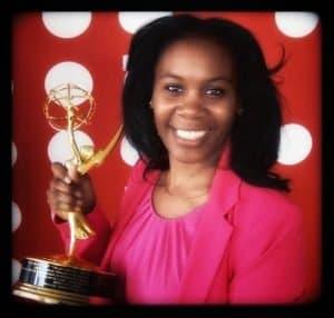 Producer Aiesha Francis holding an Emmy Award